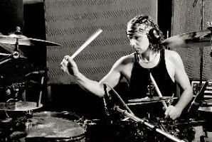 Christoph and his drumsticks in studio